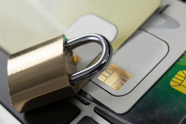 Metallic lock with smart card on laptop