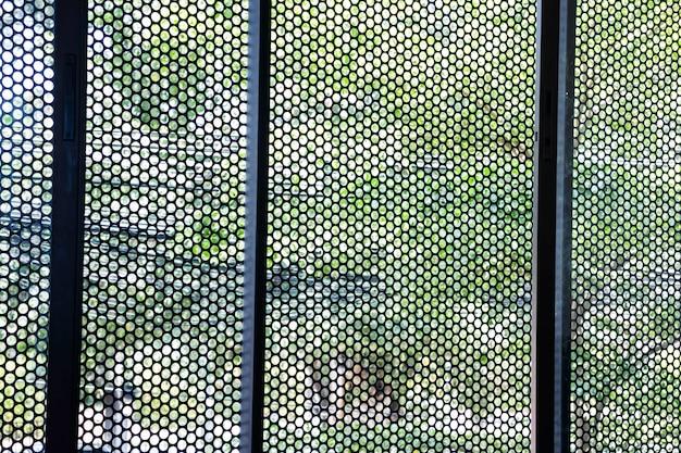 Metallic mesh grid net fence texture background