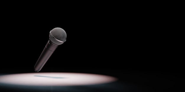 Metallic microphone spotlighted on black background