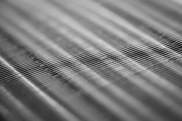 Metallic ribbed seamless texture in blur. steel.