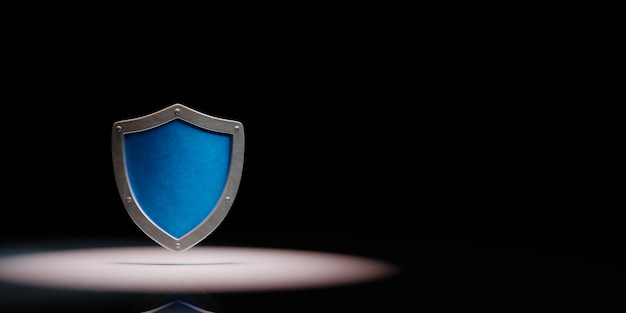 Metallic shield shape in the spotlight isolated