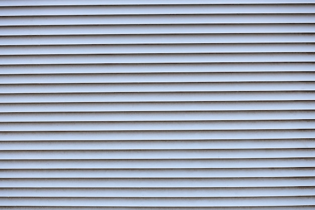 Metallic texture. horizontal straps. ventilation in a metal wall. high quality photo