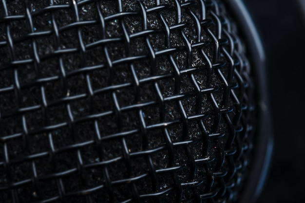 The metallic texture of the microphone grille is a full-screen close-up