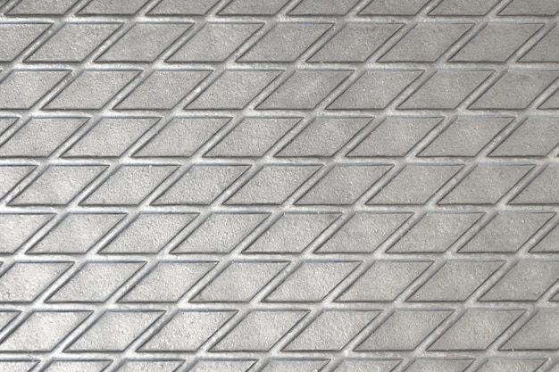 Metallic texture of a reelf shiny diamond color squares of lines intersecting.