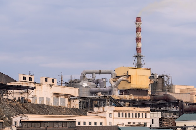 Metallurgy factory with cloudy sky