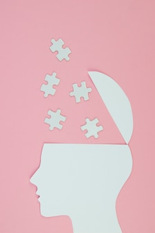 Metaphoric idea concept with head and puzzle pieces