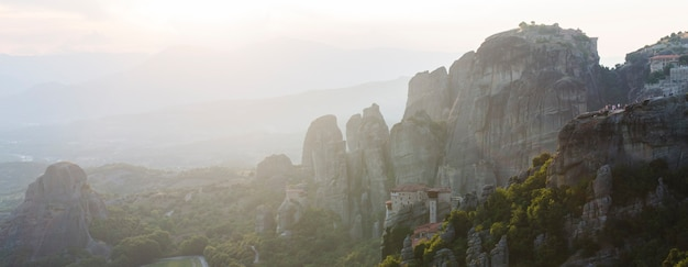Meteors monasteries in greece in high mountains on the sunset, background Premium Photo