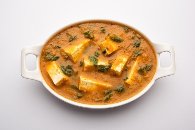 Methi paneer sabzi orindian style cottage cheese with fenugreek leaves curry recipe. served in a bowl or karahi
