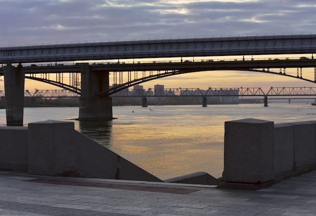 Metro bridge arched road bridge railway bridge over the ob river in the capital of siberia