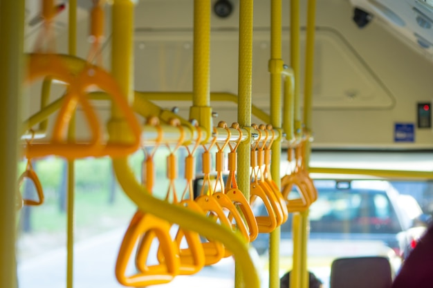 Metropolis. handrails in a public bus in the photo