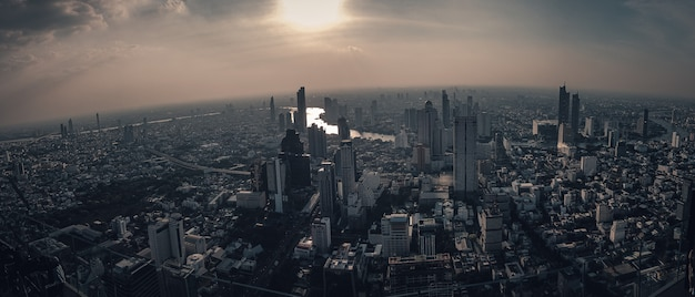 The metropolitan city is surrounded by dust smoke and pollution bangkok thailand