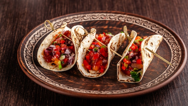 Mexican appetizer tacos with vegetables