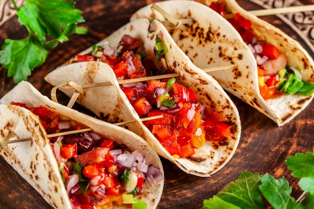 Mexican appetizer tacos with vegetables.