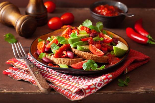 Mexican avocado bean sandwich with tomato chili scallion
