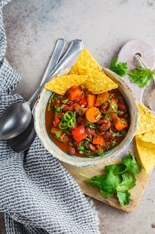 Mexican bean soup with nachos. healthy vegan food concept.