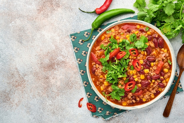 Mexican black bean soup with minced meat, tomato, cilantro, avocado and vegetables stew
