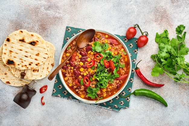 Mexican black bean soup with minced meat, tomato, cilantro, avocado and vegetables