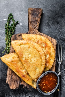 Mexican chilean food fried empanadas pie with beef meat