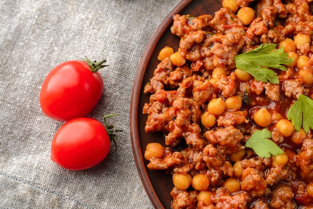 Mexican chilli with chickpeas in a clay plate