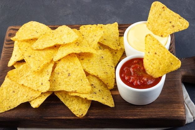 Mexican corn chips nachos with sauces