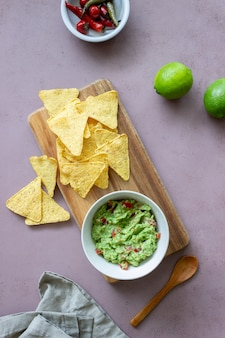 Mexican dip sauce guacamole with nachos chips. mexican food. healthy eating. vegetarian food.