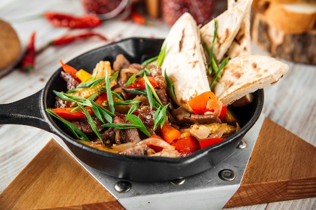 Mexican dish fajitos with beef vegetables and pita