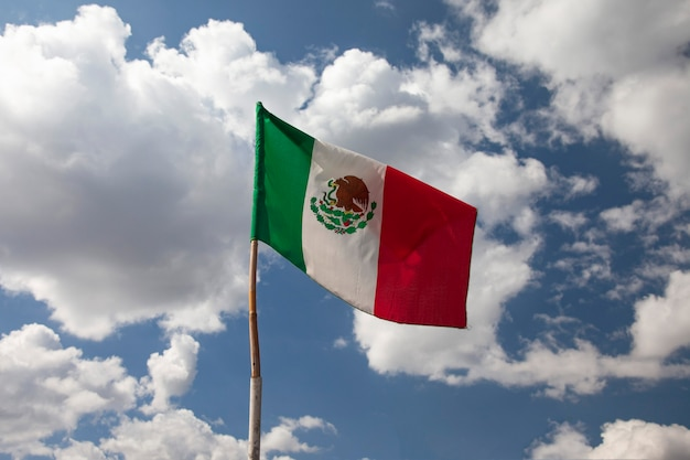 Mexican flag flying on a flagpole in a mexican house mexico independence day concept
