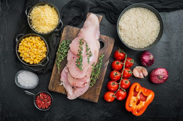Mexican food ingredients chicken enchilada, rice casserole, on black