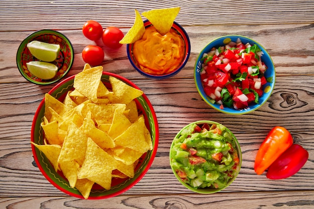 Mexican food mixed guacamole nachos chili sauce