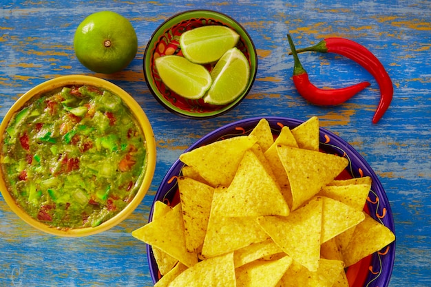 Mexican food nachos with guacamole chili peppers