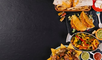 Mexican food on right side of tabletop