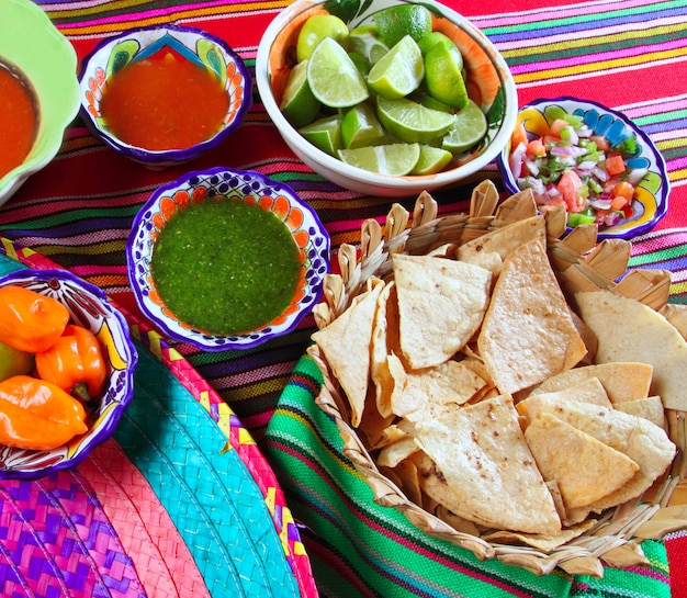 Mexican food varied chili sauces nachos lemon
