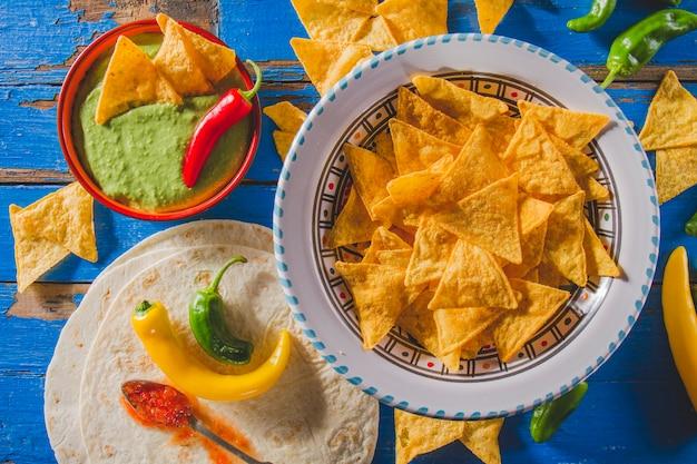 Mexican guacamole, nachos and tortilla