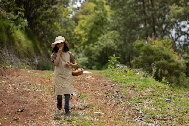 Mexican little girl walking picking peaches