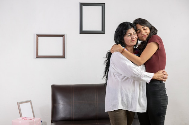 Mexican mother and daughter hug on mother's day