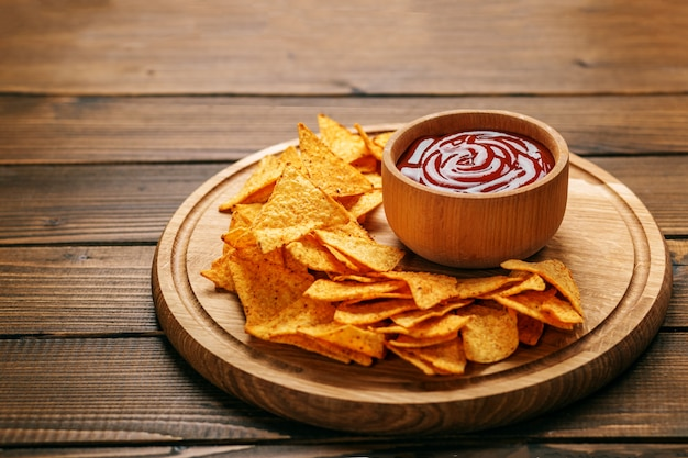 Mexican nachos chips with barbecue sauce.