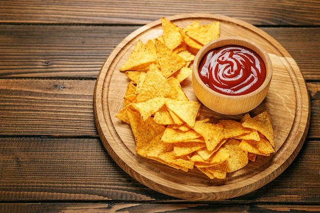 Mexican nachos chips with spicy tasty sauce.