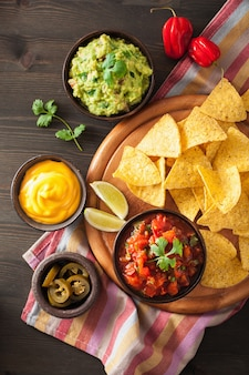 Mexican nachos tortilla chips with guacamole salsa and cheese dip