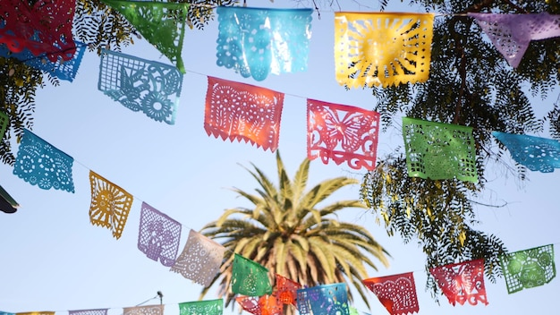 Mexican perforated papel picado banner, festival paper garland. tissue flags, holiday or carnival