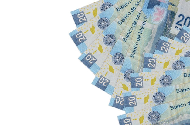 Mexican pesos bills lies isolated on white