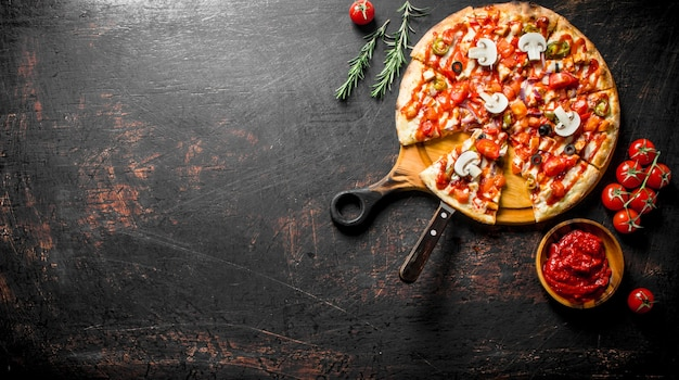 Mexican pizza with rosemary and tomato paste in bowl.