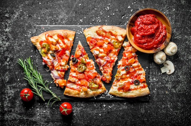 Mexican pizza with rosemary and tomato paste in bowl