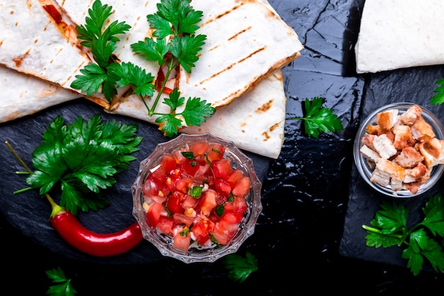 Mexican quesadilla and ingredients with salsa