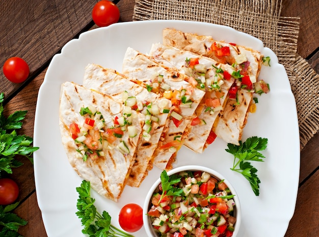 Mexican quesadilla wrap with chicken, corn and sweet pepper and sauce