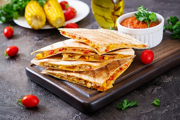 Mexican quesadilla wrap with chicken, corn and sweet pepper and tomato sauce