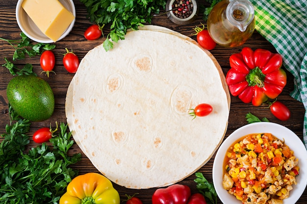 Mexican quesadilla wrap with chicken, corn and sweet pepper and tomato sauce.