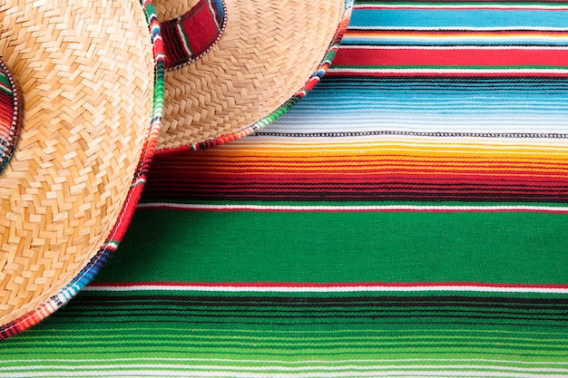 Mexican sombreros and traditional serape blanket.  space for copy.