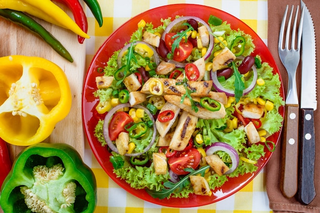 Mexican spicy chicken salad on a plate. grilled chicken meat with a tasty selection of vegetables