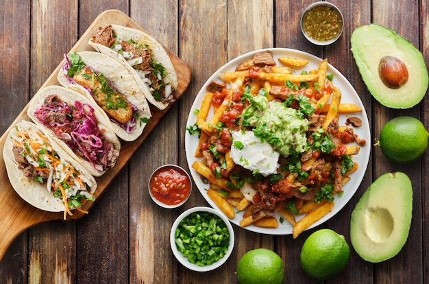Mexican street tacos and carne asada fries in flat lay composition