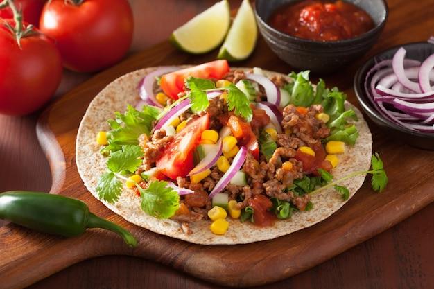 Mexican taco with beef tomato salasa onion corn